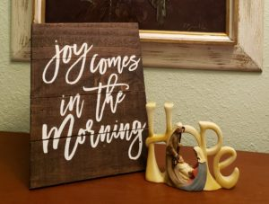 "Hope brings joy. The picture has a plaque which says, ""Joy Comes in the Morning."" with another plaque which says ""Hope."""